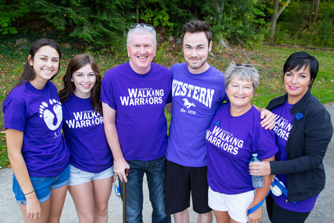 A family posing together with the Walk for ALS tshirts.